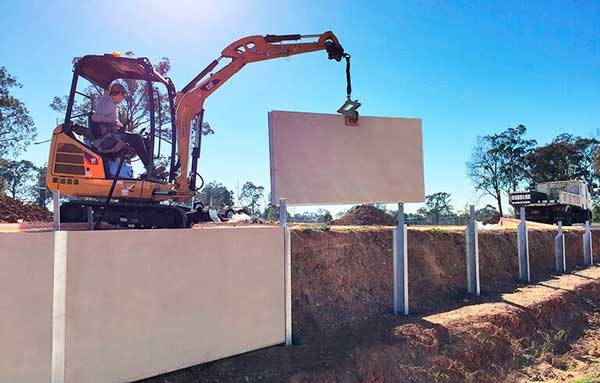 Commercial Acoustic and Retaining Wall Dog Gone Fencing