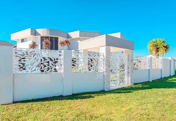 White Laser Cut Panels with Rendered Wall Dog Gone Fencing